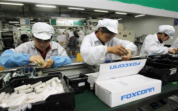 Foxconn привлечет к сборке iPhone 6 роботов