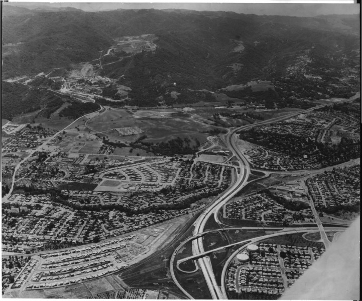 in-a-drastic-change-from-the-orchards-of-the-previous-decades-this-aerial-shot-shows-freeways-parking-lots-and-suburban-developments-dominating-the-view-of-cupertino