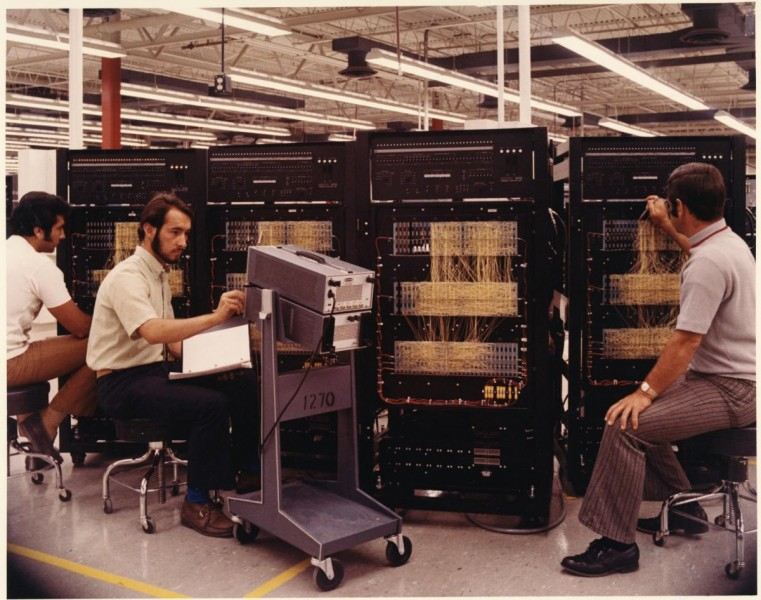 three-men-are-seen-working-on-circuit-panels-in-1965